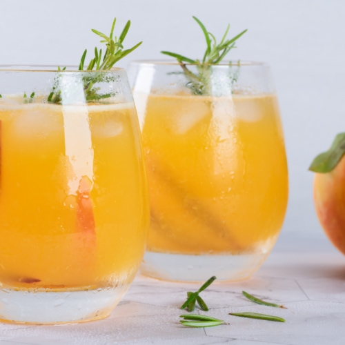 two glasses of peach sangria