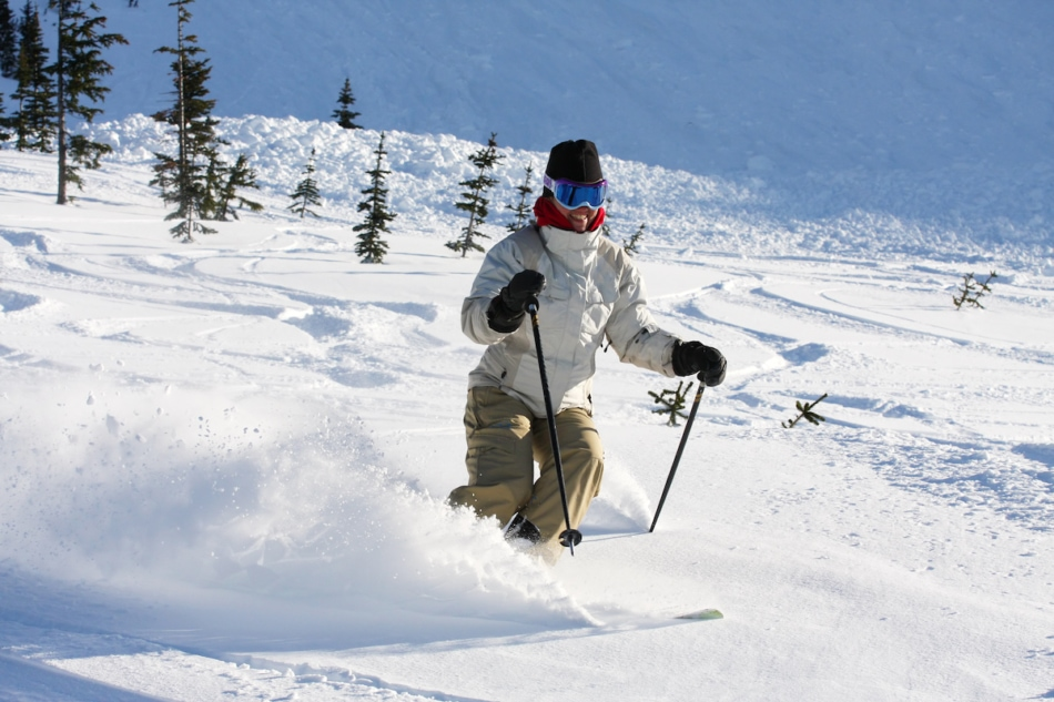 Person skiing in deep snow at Whistler Mountain.
