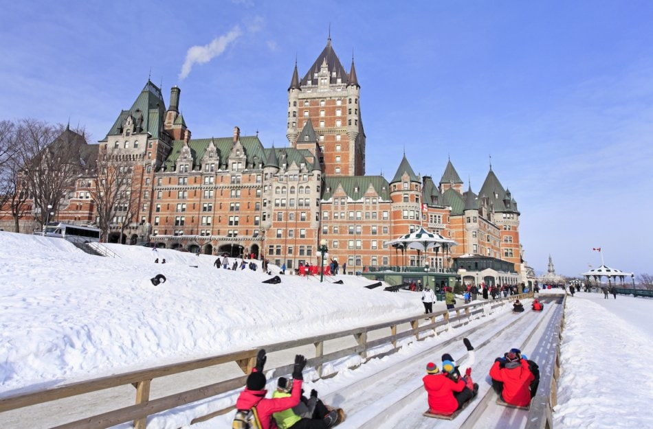 People sledding in Quebec City, Canada.