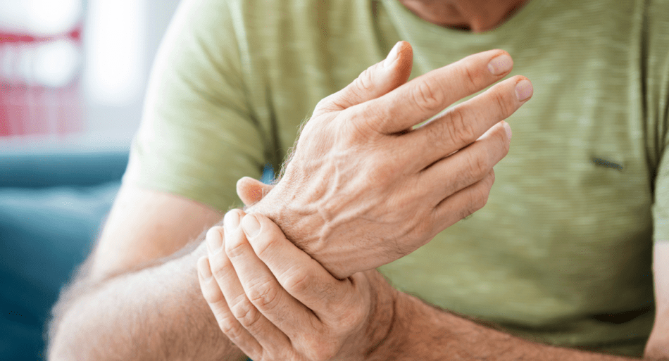 Man rubbing his sore wrist.
