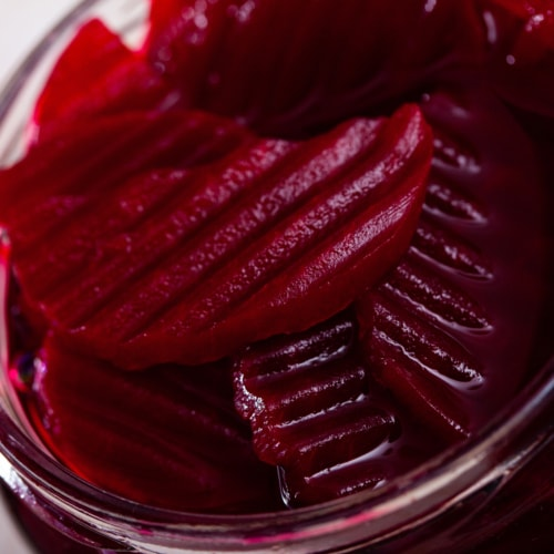 Glass jar of homemade pickled beetroot on table, natural probiotic