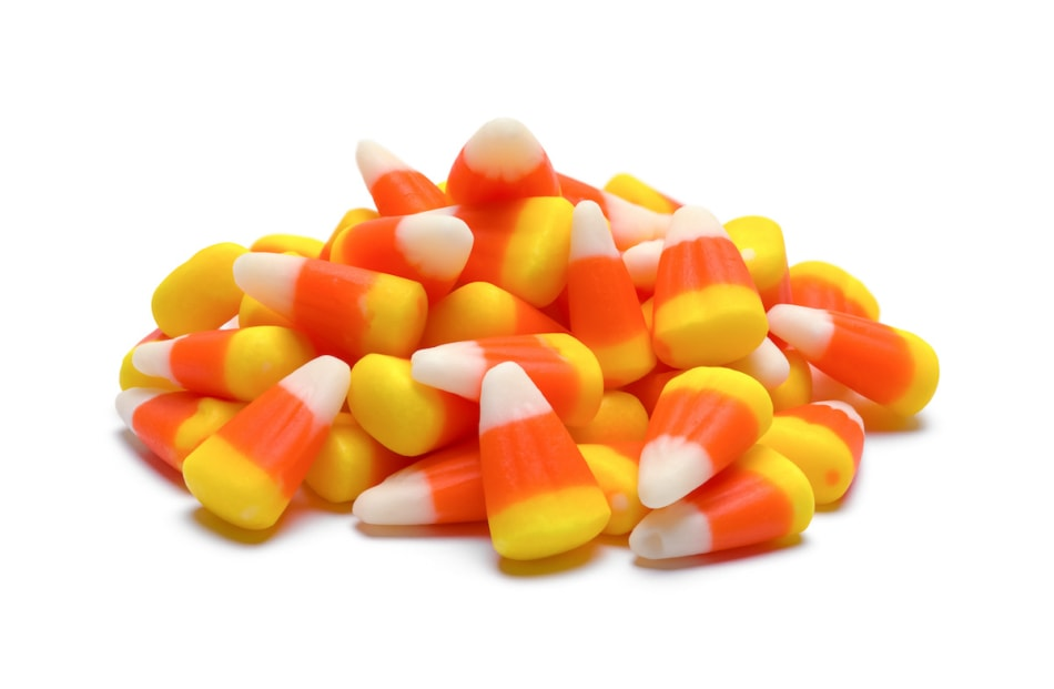 pile of candy corn isolated on white background.